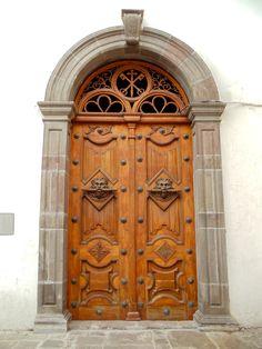 Carved wooden door in Peru