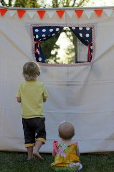 Backyard puppet theater.  Years ago I made one of these to go over the doorway in our children's bedroom.  I used a dowel and hooks or you could use a spring rod to hang the puppet theater.  It provided many hours of great fun.