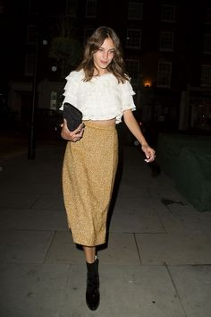 Alexa Chung in a ruffled top, midi skirt & boots #style #fashion #celebrity