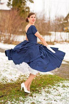 RetroCat wearing a vintage dress and petticoat