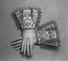 Pair of gloves  early 1600s The motif of roses, birds and wheat sheaves decorating these gloves cannot be identified with any specific association. Although a Tudor symbol, the rose was such a favourite flower in Elizabethan and Jacobean textile and decorative design that very little can be read into its appearance. While the objects embroidered were not heraldic, they may have acted as personal devices. The tradition of symbolic images chosen for tournaments,