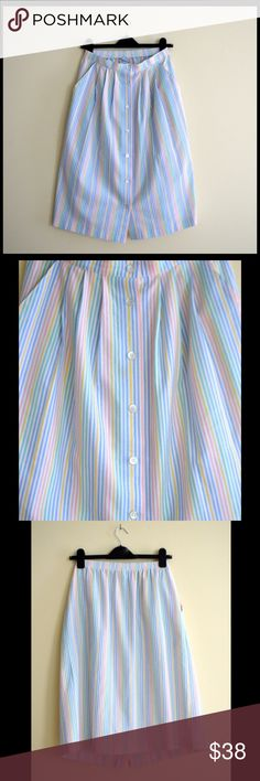 Vintage pastel midi skirt Super cute rainbow pastel midi button down skirt with two front pockets made in USA says size 6 but fits like a small waist is 12-14.5 in has elastic on back hips 19in length 26in in really good condition Vintage Skirts Midi