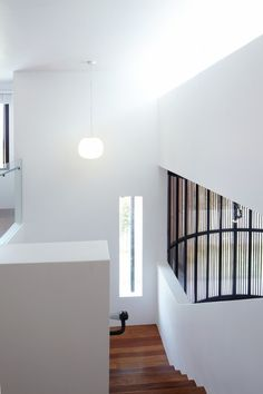 Staircase Interior Design Decorated Among Modern White Round Pendant Light Also Bright Sun Light From Skylight Window