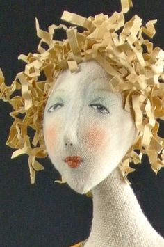 Cindee Moyer ...cut thin strips of fabric on bias and gently pull to make great hair.....vwr