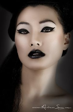 Love the contrast between her gleaming skin and the black.
