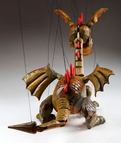 Our beautiful Dragon Spike Marionette is going to draw you into his world full of magic, legends and fairy tales. This absolutely wonderful, unique and very detailed puppet is a real masterpiece. Dragon Spike is handmade original and he will make you Marionette Puppet, Puppets, Lion Dragon, Wooden Puppet, Egg Carton Crafts, Paper Mache Sculpture, Beautiful Dragon, Puppet Crafts, Puppet Making