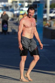Pin for Later: Hugh Jackman Takes a Break From Filming and Shows Off His Ripped Body on the Beach