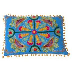 """Embroidered cotton pillow with a multicolor floral motif and pompom trim.  Product: PillowConstruction Material: CottonColor: MultiFeatures: Insert includedDimensions: 14"""" x 20""""Cleaning and Care: Spot clean"""