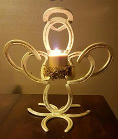 Welded Horseshoe Angel Candleholder by Brittany