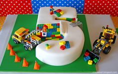 "Awesome LEGO cake being ""built"" by the toys!"