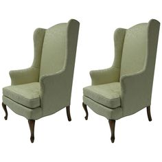 pair of petite wingback armchairs