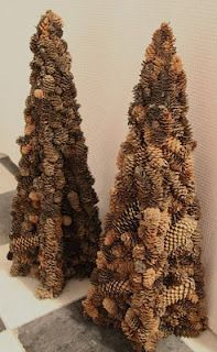 To make 3-D pinecone trees - cut two tree shapes and measure center slots so they would slide into one another and meet in the middle (they fit together kinda like those shoe storage systems). The total height of the forms is 30 inches, but you can make them any size. Glue pinecones all over, embellish with ribbon holly, nuts, berries, etc.