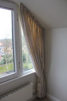 Bedroom curtains with double pinch pleat heading in Casadeco fabric. Designed by Just So Interiors