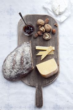 Bread, nuts, cheese, and jam.
