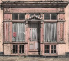 Pink facade of very old building