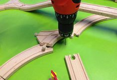 Securing Train Board Tracks, what a great idea. How to build a train track board ideas. Two Year Old Christmas Gifts, Toddler Christmas Gifts, Christmas Wishes, Ikea Train, Activities For 1 Year Olds, Kids Play Table, How To Make Toys, Wooden Train, Thomas The Train