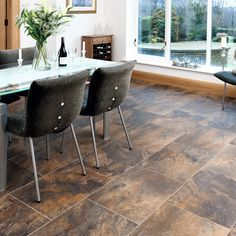 By choosing Karndean Designflooring it's possible to design a space that is warm and welcoming, without compromising on practicality or comfort. Aptly named after its hometown, Melbourne Slate, featured here, has been handcrafted to perfectly match the original slate fragments recovered from 'Parliament House', with a rich and forgiving multi-colour design mix of mid- greys, blue, orange and earth-browns. Request your free sample today! Discount Vinyl Flooring, Cheap Vinyl Flooring, Vinyl Garage Flooring, Vinyl Flooring Bathroom, Luxury Vinyl Flooring, Vinyl Tiles, Vinyl Plank Flooring, Stone Flooring, Laminate Flooring