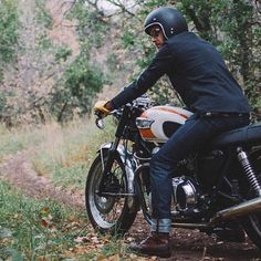 A beautiful Triumph bike with a pair of Red Wing Shoes Iron Ranger 8111 Amber Harness
