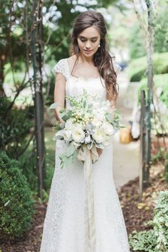 Lace #wedding dress by Sareh Nouri from White Dresses in Huntsville, AL. Bouquet by LSL Event Design with ribbon from Froufrou Chic. Image by Leslie Hollingsworth. #bride #bridal