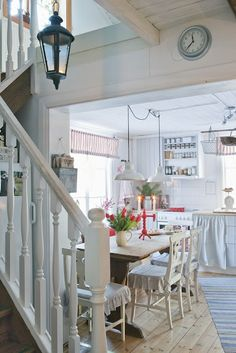 That's it... I'm officially in love: the stairway into the kitchen, the trestle table, the sink skirt, it's the whole package.