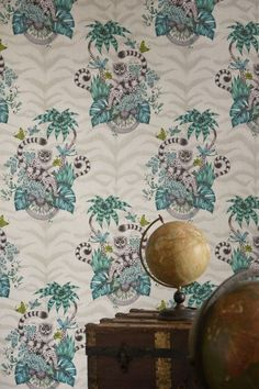 Whimsical wallpaper pattern by Emma J Shipley for Clarke & Clarke featuring a repeated cameo motif of a quizzical lemur, surrounded by jungle palms. Green Wallpaper, Animal Wallpaper, Pattern Wallpaper, Room Wallpaper, Shades Of Green, Green And Grey, Funky Living Rooms, Jungle Scene, Statement Wall
