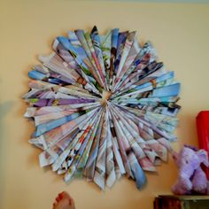 Rolled up magazine pages glued together. Great simple bedroom wall decoration!