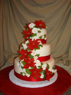 Poinsettia Wedding Cake - The poinsettias and roses are gumpaste. I used JEM cutters and Marcela Sanchez's gumpaste, both purchased from Global Sugar Art.