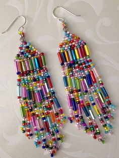 Super beaded confetti long beaded seed bead earrings - pearl jewelry - Beautiful, super long seed bead beaded earrings with bright metallic mirror bugles and multicolored - Beaded Necklace Patterns, Jewelry Patterns, Beading Patterns, Seed Bead Patterns, Bead Jewellery, Beaded Jewelry, Beaded Bracelets, Diy Jewelry, Bead Jewelry
