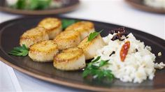 Spiced compound butter makes these pan-roasted scallops so flavorful