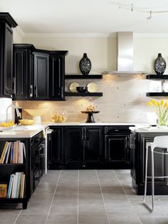 A neutral palette with modern black kitchen cabinets and vibrant home accessories to create a show stopping look.
