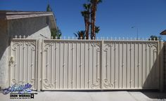 Powder coated wrought iron driveway gate and matching side gate with scrolls, knuckles, fleur de lis finials and solid backing. Double Gate, Double Doors, Wrought Iron Driveway Gates, Side Gates, Boulder City, North Las Vegas, Door Gate, Block Wall, Bouldering