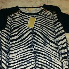 Michael Kors dress shirt Solid Blue arms. Blue and white animal print. Gold zippers on shoulders. Michael Kors Tops Blouses