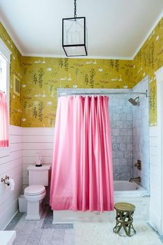 Nina Campbell Swan Lake Wallpaper - pink, white, and chartreuse bathroom with white subway tile