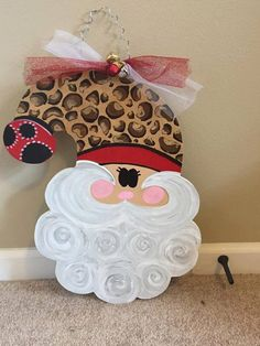 A personal favorite from my Etsy shop https://www.etsy.com/listing/468472745/santa-door-hanger-christmas-door-hanger