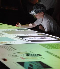 Create your own propaganda poster on the Museum's interactive tables!