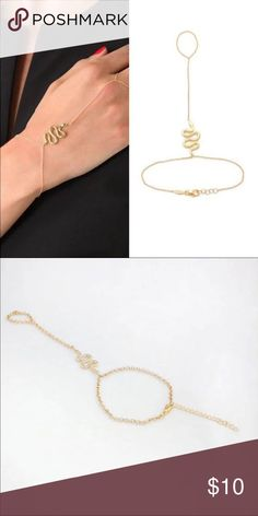 """Snake Bracelet & Ring Cute bracelet with attached ring. Gold toned alloy. Bracelet can latch anywhere from about 7""""- 8.75"""". New in package. The ring part fits up to about a size 9 :). Jewelry Bracelets"""