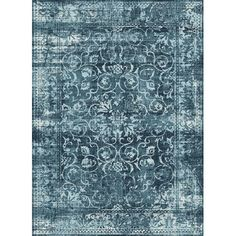 Soft, muted scrollwork form a chic pattern on this transitional area rug. The subtle washed appearance adds to the vintage appeal. Made of 100% polypropyl...