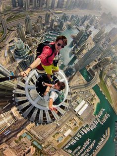 Vertigo Inducing Selfies by Russian Photographer  Nineteen year old Russian daredevil Alexander Remnev and his group of thrill-seekers like to hang out from the top of tall buildings. Once they are at the top, Remnew will whisk out a camera attached to a long pole and take selfies of their accomplishments. Remnev's stomach churning photos show him and his friends dangling precariously at astonishing heights, sometimes holding on to the ledge or some structure with a single hand.