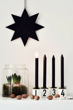 Black star ornament and numbered black advent candles