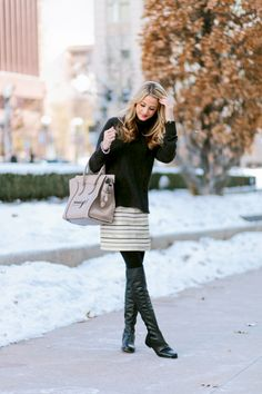 Mix a black sweater and boots with a cute, striped skirt. Pink lip gloss add an extra feminine touch. http://www.thestyleup.com/style/g5jty