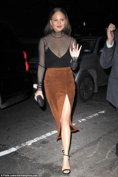 Chrissy Teigen wearing Sally Lapointe Suede High Slit Skirt, Mm6 Maison Margiela Turtleneck Mesh Top and Jeffrey Levinson Elina Clutch