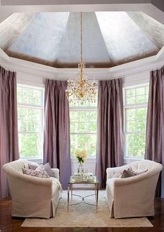 Turreted silver leaf ceiling + fabulous draperies in this master bedroom sitting area. by deanna