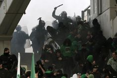 Police forces and fans clash during Panthanaikos vs Olympiakos game in Greece