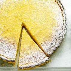Raymond Blanc's tart is a treat and one of his favourite recipes. Try adding some ripe figs, cut in half, to the lemon and cream mixture before you bake it. Or serve it as it's shown on the cover of some of this month's delicious. magazines – with quartered strawberries.