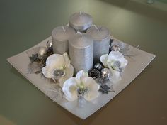 Gift this stunning candle hamper to your family and friends this Christmas or light them at your place and take all the praises! Christmas Advent Wreath, Silver Christmas Decorations, Christmas Lanterns, Christmas Holidays, Christmas Crafts, Xmas, Table Flower Arrangements, Christmas Floral Arrangements, Winter Wonderland Decorations