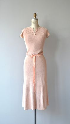 Vintage 1930s ballet pink cotton knit dress with lovely pointelle/lace knit neckline, short sleeves and ribbon drawstring waist. --- M E A S U R E M E N T S --- fits like: xs/small/medium bust: 32-34 waist: 24-28 hip: up to 38 length: 49 brand/maker: n/a condition: excellent to ensure a good fit, please read the sizing guide: http://www.etsy.com/shop/DearGolden/policy ✩ layaway is available for this item ✩ more vintage dresses ✩ http:&#x2F...