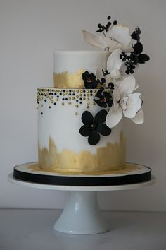 Gold and black floral 2 tier wedding cake
