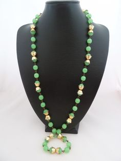 Art Deco style Peking glass bead necklace with gold tone end caps.  Probably 70s