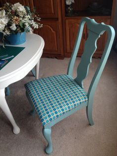 Chalk painted dining room chairs and table. Recovered seats with fabric from Joann Fabric.