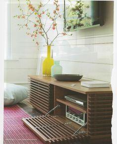 stereo cabinet + flowers + vases